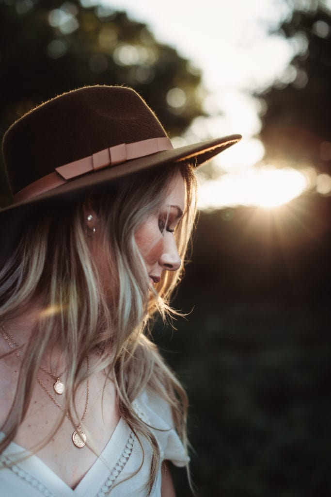 Senior Photographer, close up shot of woman in a wide brim hat