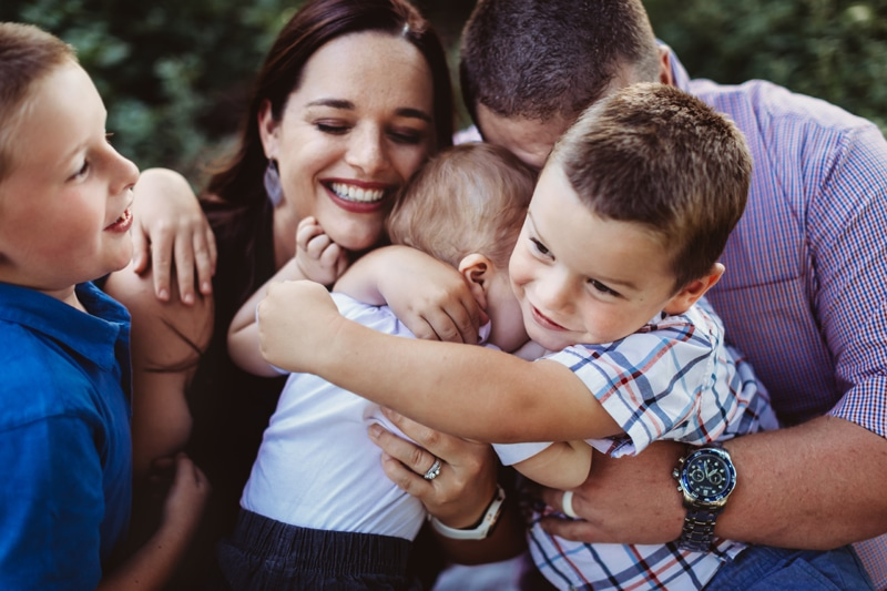 Family Photographer, family of 5 hugging closely