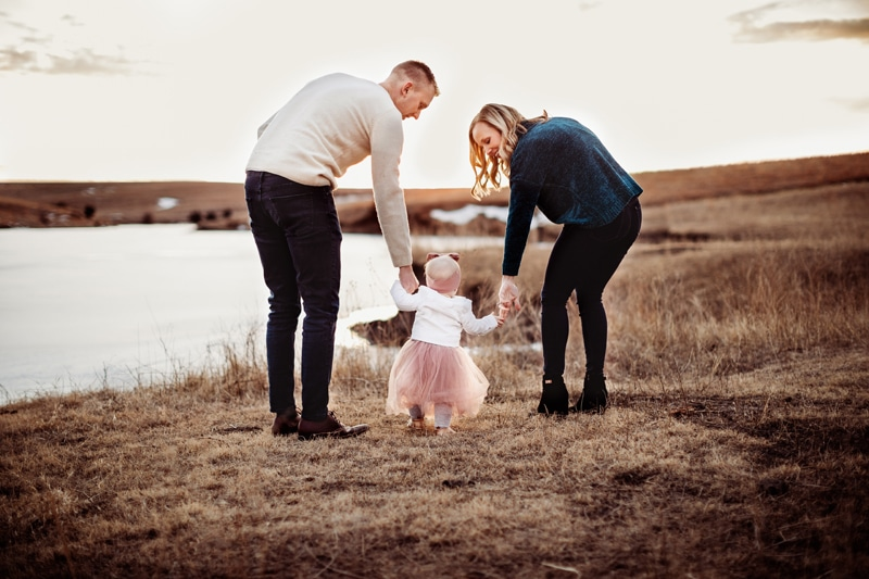 Temecula Family Photographer, couple holding little girl's hands and going for a walk